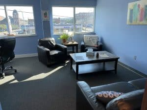 Scranton office with city views and couches around coffee table
