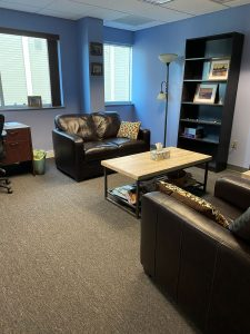 Scranton office with couches and bookshelf